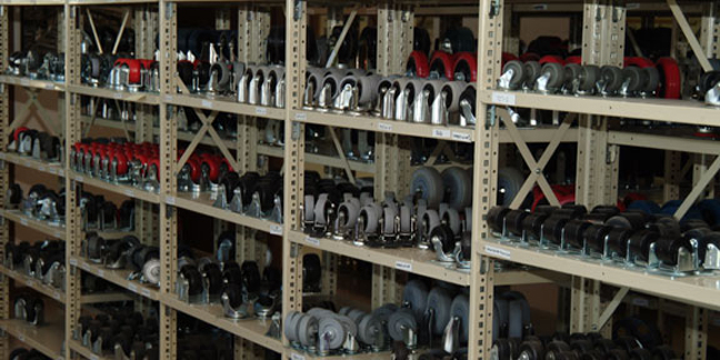 Large quantity of casters on shelves