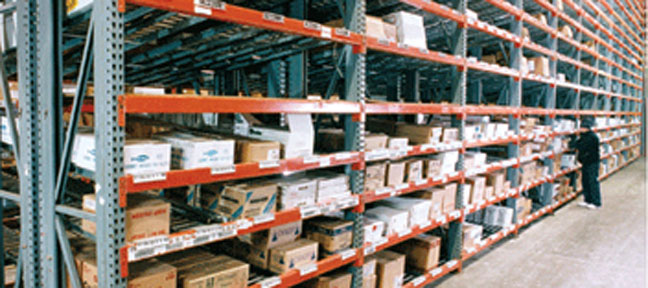 close up of industrial shelving with boxes of inventory